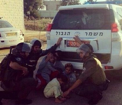 Israeli soldiers protecting Arab kids from rockets flying in from Gaza into Israel